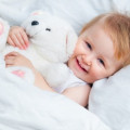 Video: How to Introduce Your Child to Sleeping in a Bed