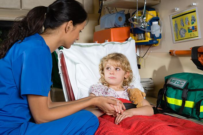 little girl and nurse in ambulance.final
