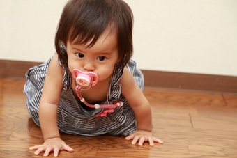 Japanese baby girl sucking on a pacifier (0 year old)