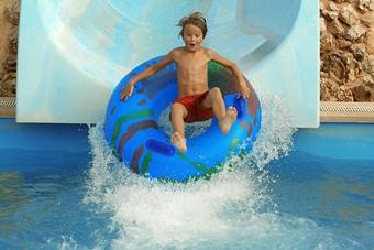 Boy on slide in water park