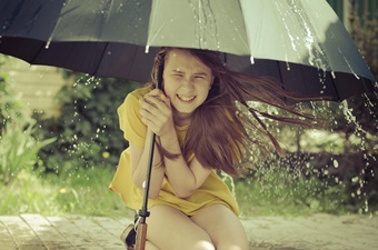 girl_under_umbrella_hurricane