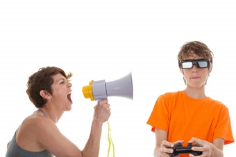 angry mother of teen playing computer games